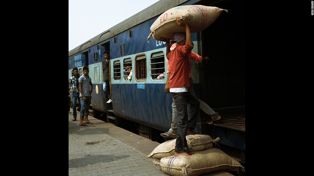 Workers load goods onto a train at Guwahati station in Assam.