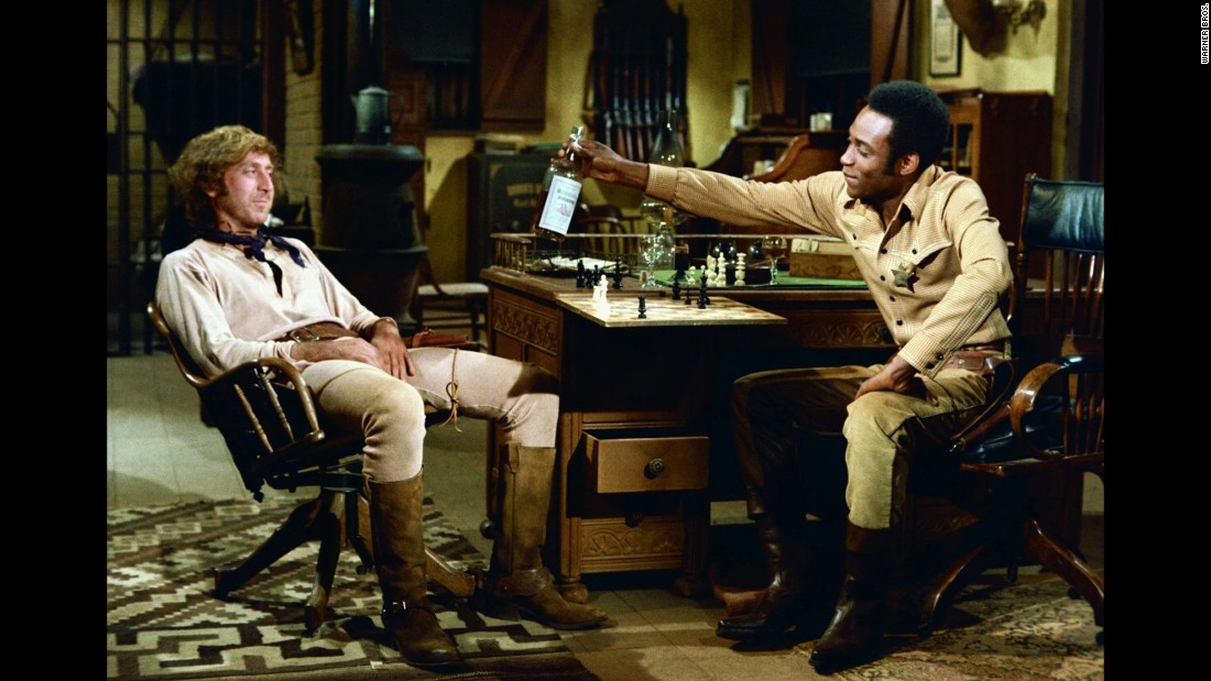 """Wilder, seen here with Cleavon Little, was back with Brooks for 1974's """"Blazing Saddles."""" In a statement to CNN on Monday, Brooks called Wilder """"one of the truly great talents of our time. ... He blessed every film we did together with his special magic. And he blessed my life with his friendship."""""""