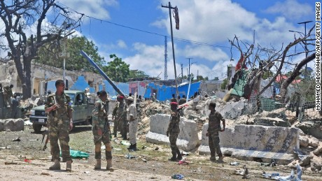 Somali security forces patrol the scene of a suicide car bomb blast on August 30, 2016 in Mogadishu.