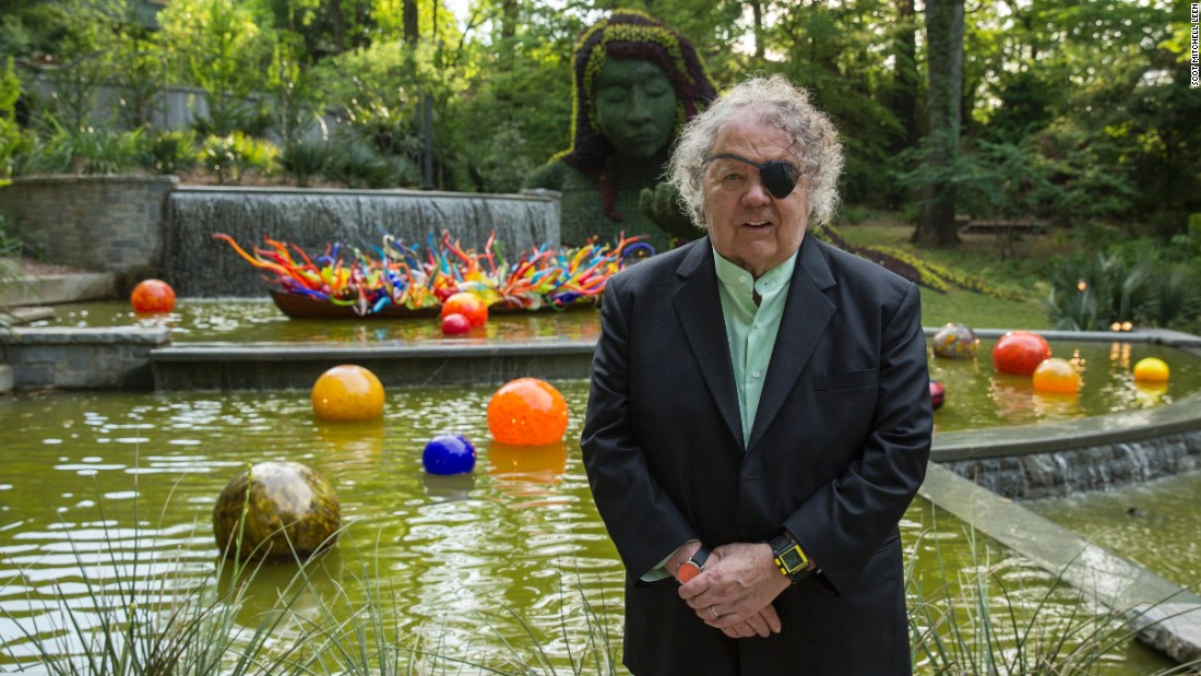 """Artist Dale Chihuly's latest show at the Atlanta Botanical Garden features 19 installations throughout the 30-acre garden. """"Fiori Boat and Niijima Floats"""" is behind him at the base of the Earth Goddess in the Cascades Garden."""