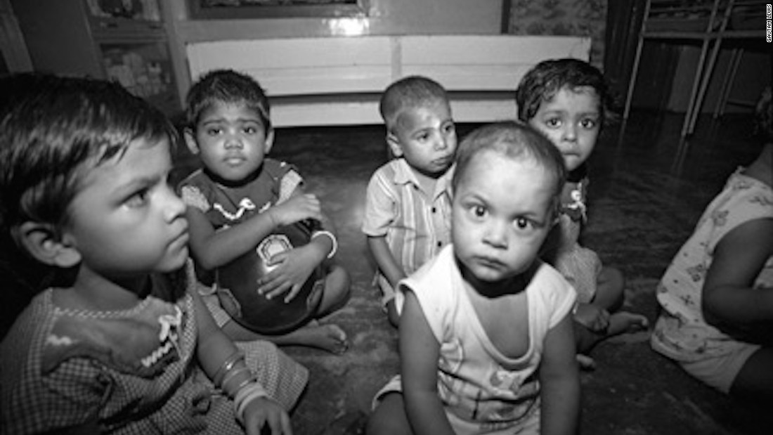 """These orphans, photographed by Gautam in 2009, were rescued by the Missionaries of Charity and taken to Shishu Bhavan. Gautam says the time he spent at the home was tough.  """"My memories from that period are dark, sad, and lonely,"""" he says."""