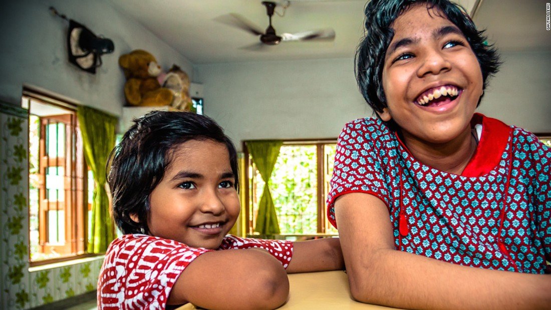 """Gautam photographed these sisters, who have stayed together as orphans at the children's home in the care of the Missionaries of Charity. """"I probably have brothers and sisters but I don't know who they are,"""" says Gautam."""