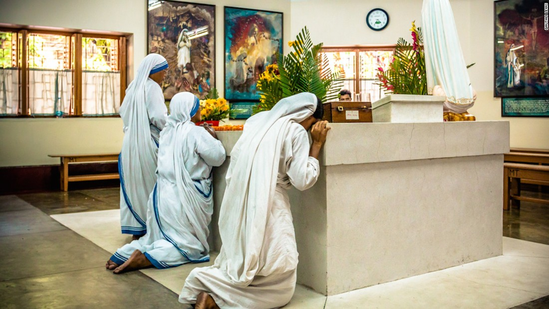 """Gautam Lewis is a pilot, photographer and polio survivor. He spent his early years under the care of Mother Teresa. He photographed these sisters praying on the tomb of Mother Teresa in May 2016. """"It was very emotional being there,"""" he says."""