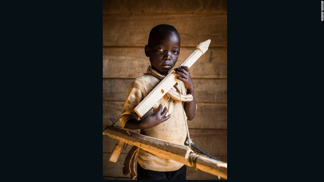 """Paradoxe (Soldier), Democratic Republic of the Congo. """"I don't know my exact age, and I don't go to school. One day I will be a soldier, to fight other soldiers. Soldiers are not kind because they killed my brother""""."""