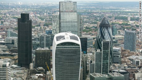 The City of London's Eastern cluster features quirky skyscrapers such as the Gherkin (R) and the 'Walkie Talkie' (C front).