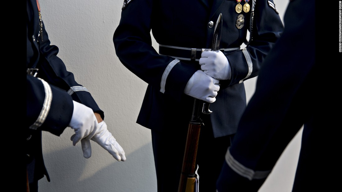 Honor guard members from the U.S. Coast Guard prepare for the arrival ceremony of Singaporean Prime Minister Lee Hsien Loong, who was visiting the White House for a state dinner on Tuesday, August 2.