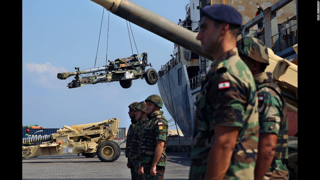 Lebanese troops stand guard near a ship as weapons from the United States are unloaded at Beirut's port on Tuesday, August 9. The United States delivered an entire ship full of military equipment, including vehicles, ammunition and artillery pieces.