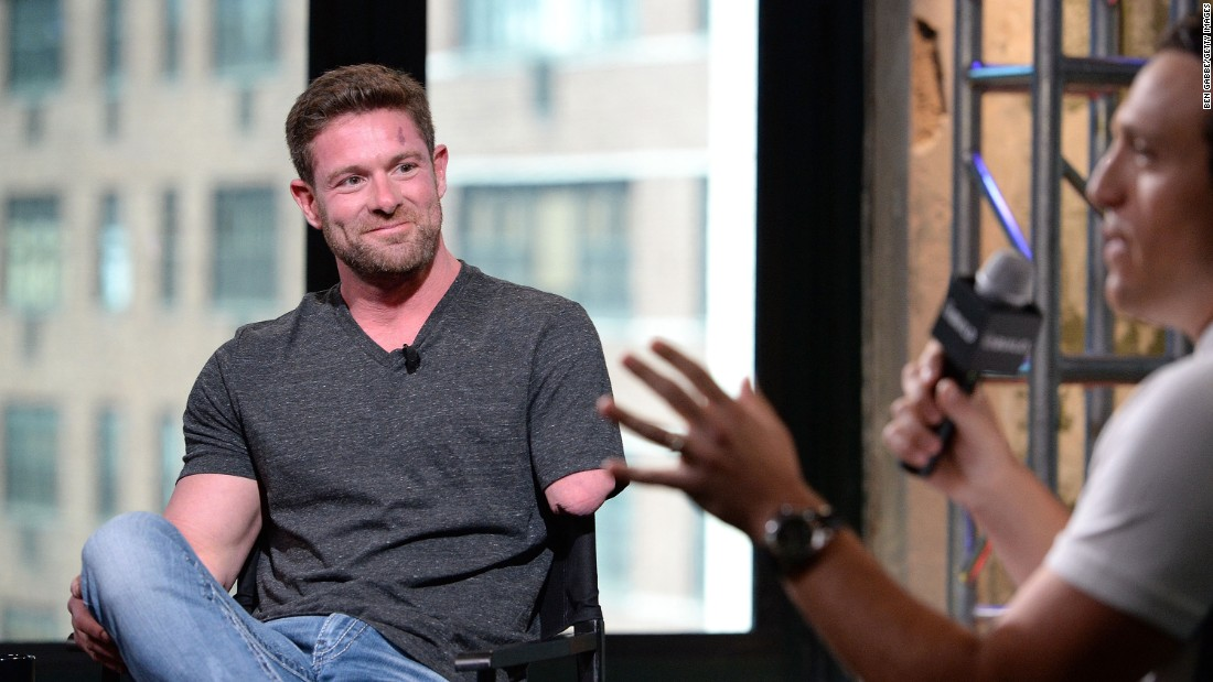 "Former U.S. Army soldier Noah Galloway, left, discusses his book ""Living With No Excuses"" during an interview in New York on Tuesday, August 23. Galloway lost his left arm above the elbow and his left leg above the knee when the Humvee he was in was hit by a roadside bomb in Iraq. But he <a href=""http://www.cnn.com/2012/07/30/us/iyw-noah-galloway/"" target=""_blank"">continues to compete in grueling races and obstacle courses,</a> and he is passionate about helping other veterans recover."