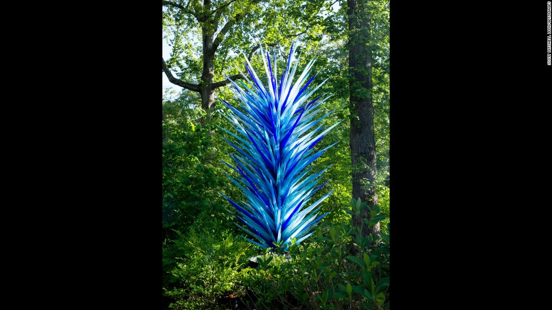"""The """"Indigo Blue Icicle Tower,"""" which was created for the current exhibition, greets visitors to the garden."""