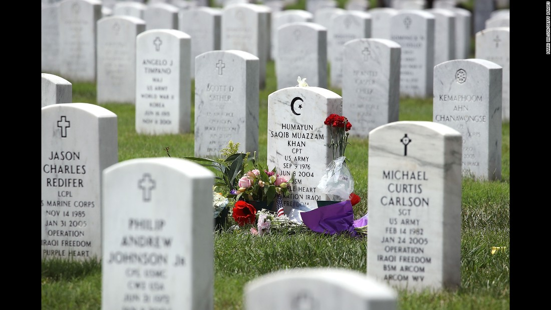 "Flowers rest at the gravesite of U.S. Army Capt. Humayun Khan at Arlington National Cemetery on Monday, August 1. Khan, a Muslim-American, was killed while serving in Afghanistan in 2004. His parents have become embroiled in <a href=""http://www.cnn.com/2016/07/31/politics/donald-trump-khizr-khan-family-controversy/index.html"" target=""_blank"">a high-profile feud</a> with Republican presidential candidate Donald Trump after Khan's father, Khizr, criticized Trump in an emotional speech at the Democratic National Convention."