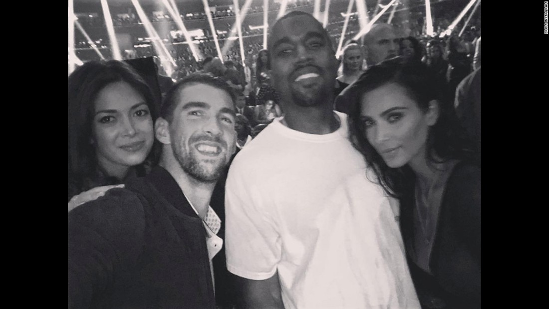 "Olympic legend Michael Phelps, second from left, posted this selfie from the MTV Video Music Awards on Monday, August 29. Phelps is with his fiancee, Nicole Johnson; rapper Kanye West; and television personality Kim Kardashian. ""This one is for you bro!!"" the swimmer <a href=""https://www.instagram.com/p/BJrshPHgeEp/"" target=""_blank"">said on Instagram.</a> ""Fun night!!"""