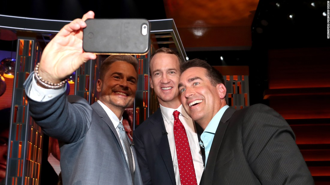 Actor Rob Lowe takes a selfie with former NFL quarterback Peyton Manning, center, and actor Rob Riggle during Lowe's Comedy Central roast on Saturday, August 27. The show airs next week.
