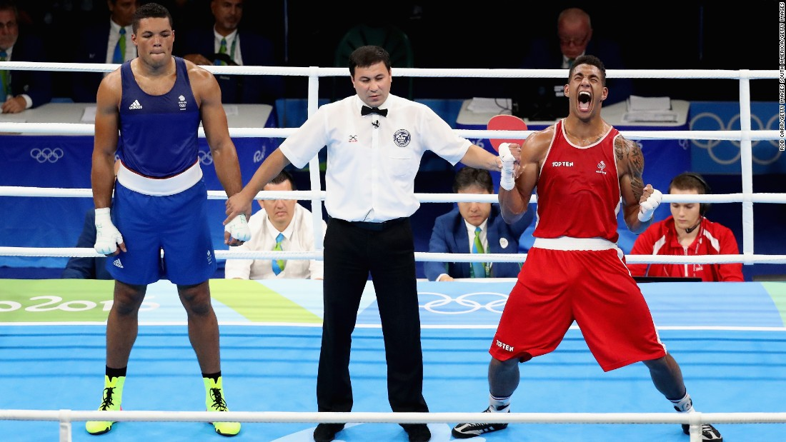 Joyce (L) represented Britain at the Rio 2016 Olympics but lost a controversial super heavyweight gold medal match to Tony Yoka of France. Sid Khan is critical of amateur boxing's reformed scoring system, along with the removal of headgear and the introduction of professionals into the Olympics.