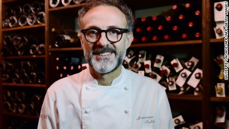"""A picture taken on July 7, 2016 shows Italian chef Massimo Bottura posing in the kitchen of his restaurant """"Osteria Francescana"""" in Modena.  / AFP / GIUSEPPE CACACE        (Photo credit should read GIUSEPPE CACACE/AFP/Getty Images)"""