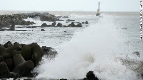 Waves beat against the seashore in Ishinomaki, Miyagi prefecture, on August 30, 2016 as Typhoon Lionrock makes its course towards northeastern Japan.   A strong typhoon was on course to directly hit Japan's northeast on August 30, with authorities warning of heavy rain and high waves along the Pacific coast devastated by the 2011 monster tsunami. / AFP / JIJI PRESS / JIJI PRESS / Japan OUT        (Photo credit should read JIJI PRESS/AFP/Getty Images)