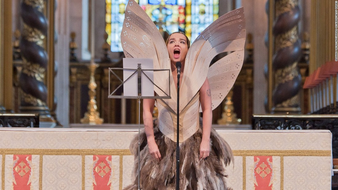 Björk performs at the Alexander McQueen memorial service at St Pauls Cathedral in London wearing garments by the late designer.