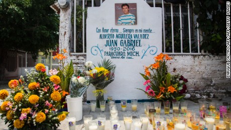 """Candles and flowers are seen in an altar erected in front of the house where Mexican composer and singer Alberto Aguilera, known as """"Juan Gabriel"""" was born in Paracuaro, Michoacan state, Mexico on August 29, 2016.  Mexico and the music world on Monday mourned the death of legendary singer Juan Gabriel, who touched millions with wrenching ballads of love and loneliness as he rose from the rough streets of Ciudad Juarez to a world stage. / AFP / ENRIQUE CASTRO        (Photo credit should read ENRIQUE CASTRO/AFP/Getty Images)"""