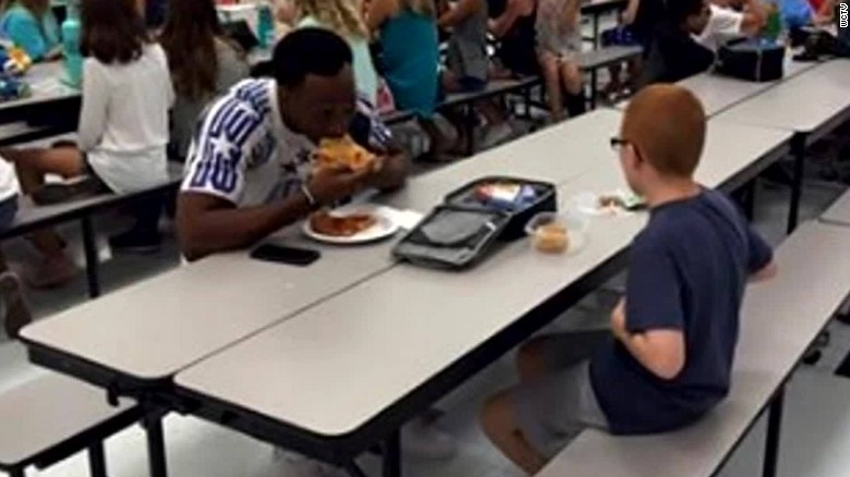 fsu football player sits lunch pkg_00011219