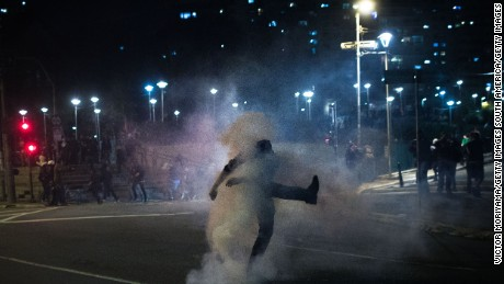 Pro-Rousseff protesters clash with police during Wednesday night's march in Sao Paulo.