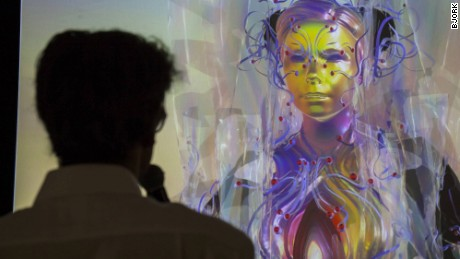 Björk's avatar beams down on media in London in a press conference.