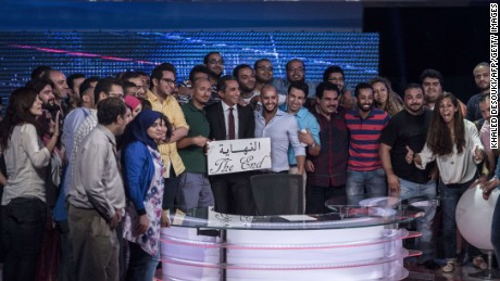 """Youssef and his team hold a card that reads """"the end"""" in Arabic to announce the end of """"Al-Bernameg"""" in Cairo, Egypt on June 2, 2014."""