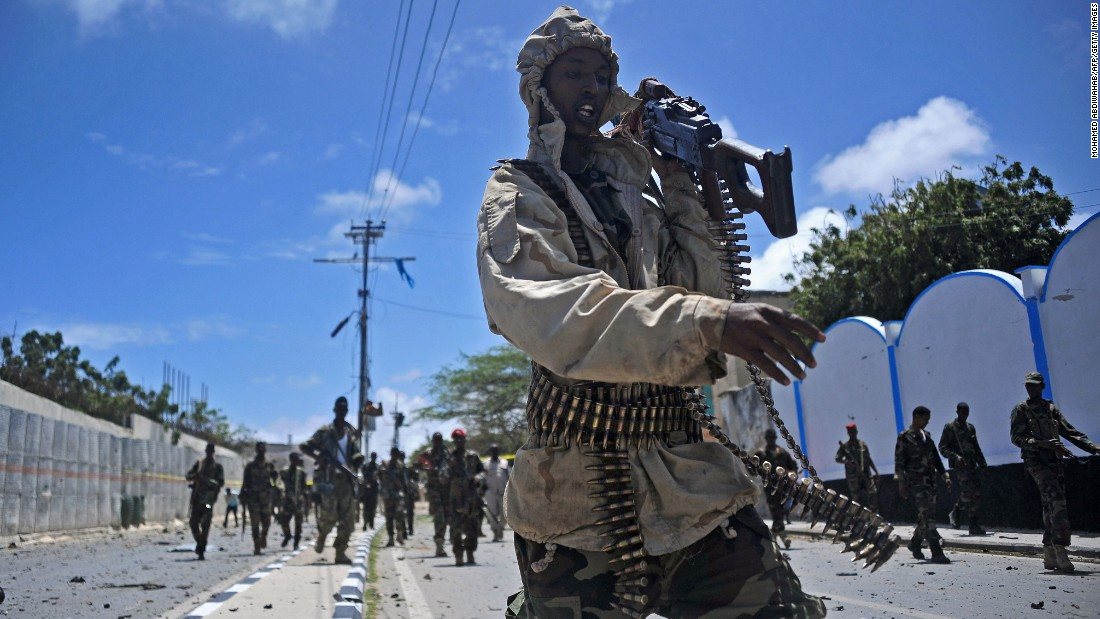 "Somali forces patrol the scene of a car bombing in Mogadishu on Tuesday, August 30. The terrorist group Al-Shabaab <a href=""http://www.cnn.com/2016/08/30/africa/somalia-truck-bomb/"" target=""_blank"">claimed responsibility for the attack,</a> which killed at least 15 people outside the Somali presidential palace and the popular Somali Youth League Hotel."
