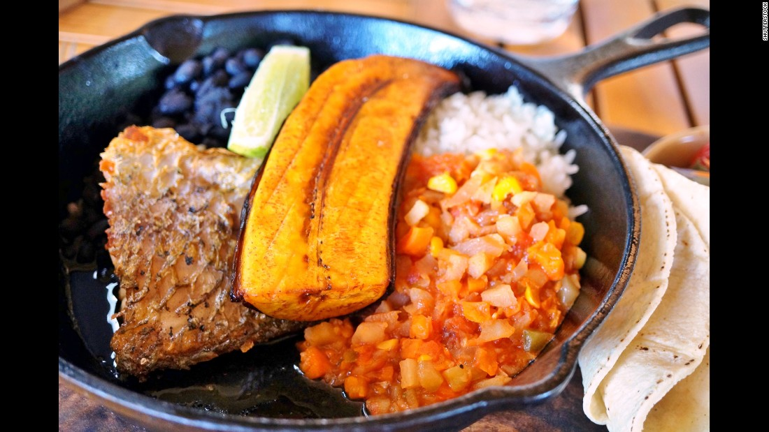 Native tubors, such as yams, are a common ingredient. Pictured, a traditional Costa Rican casado meal with rice, beans and plantain.