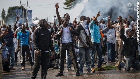 Opposition supporters clash with police in Gabon's capital, Libreville, on August 31.