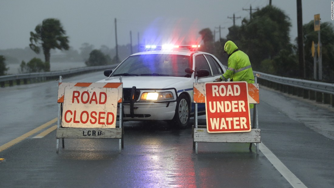 A police car blocks a flooded road that leads to Cedar Key on September 1.