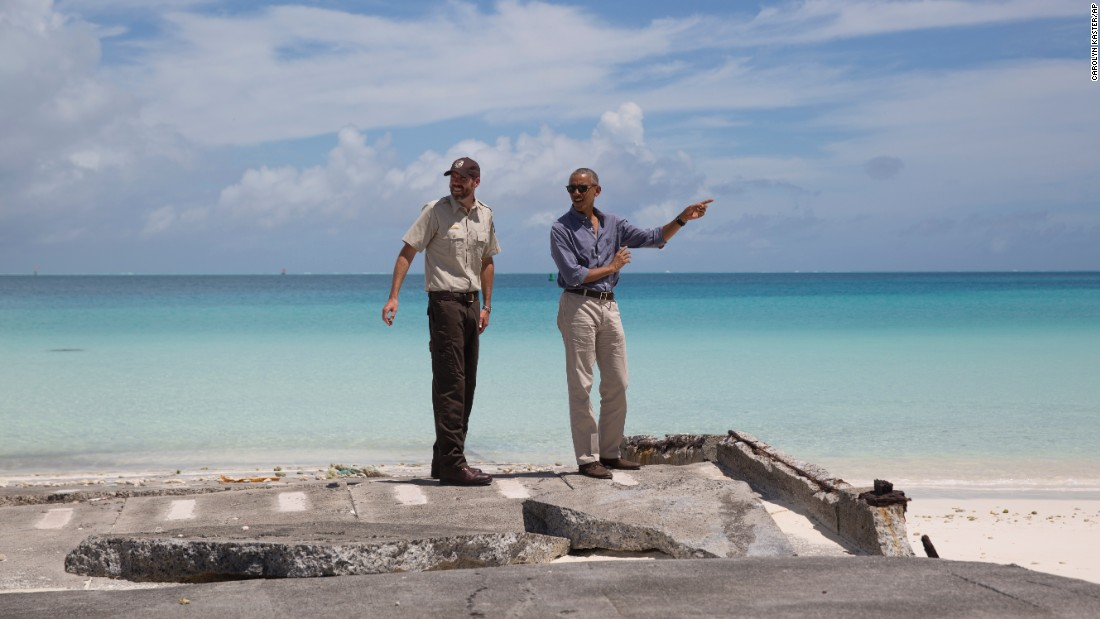 """U.S. President Barack Obama, right, visits Turtle Beach during <a href=""""http://www.cnn.com/2016/09/01/politics/midway-obama-preview/"""" target=""""_blank"""">a tour of the remote Midway Atoll, </a>which is off the coast of his native Hawaii on Thursday, September 1. Obama is expanding the Papahanaumokuakea Marine National Monument there, establishing the largest protected marine sanctuary in the world."""