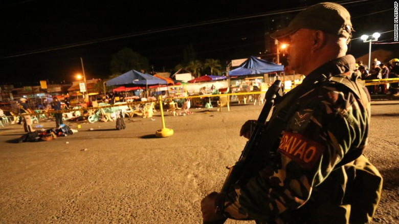 A soldier keeps watch at a blast site in Davao City in the Philippines.