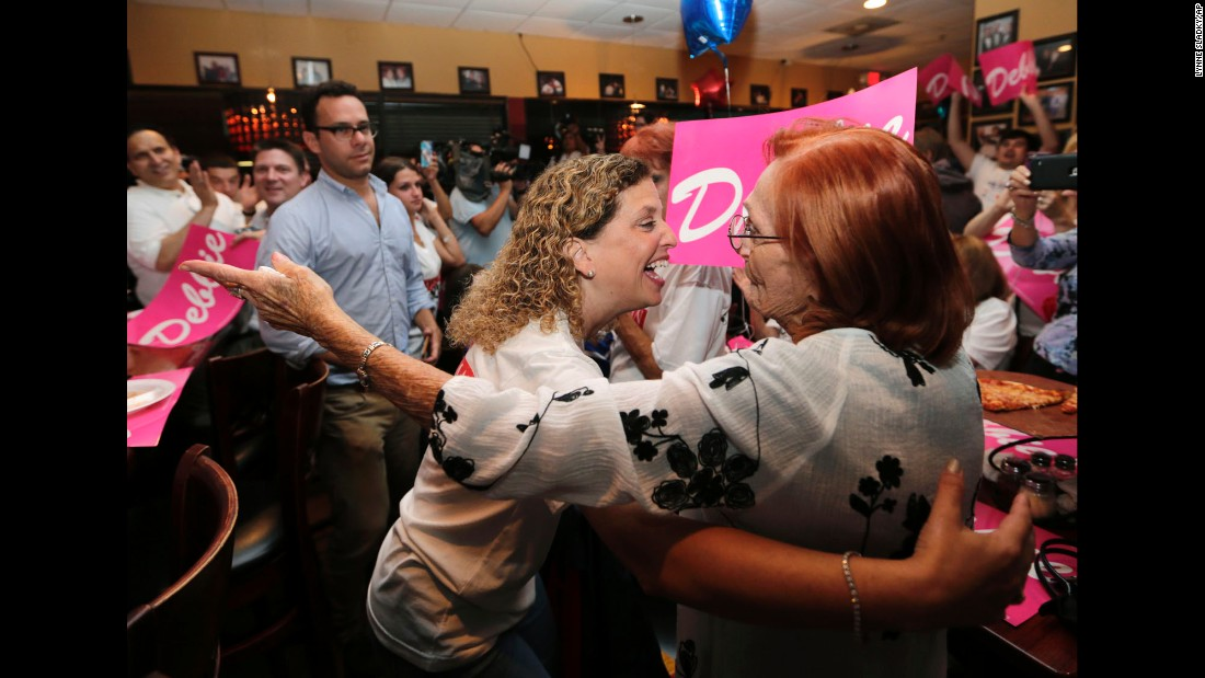 """U.S. Rep. Debbie Wasserman Schultz, center, hugs a supporter in Sunrise, Florida, on Tuesday, August 30 -- primary election night. Wasserman Schultz <a href=""""http://www.cnn.com/2016/08/30/politics/john-mccain-debbie-wasserman-schultz-marco-rubio-primary/"""" target=""""_blank"""">won her race</a> despite recent political difficulties. Two months ago, in the wake of a Wikileaks hack, she resigned as chairwoman of the Democratic National Committee."""