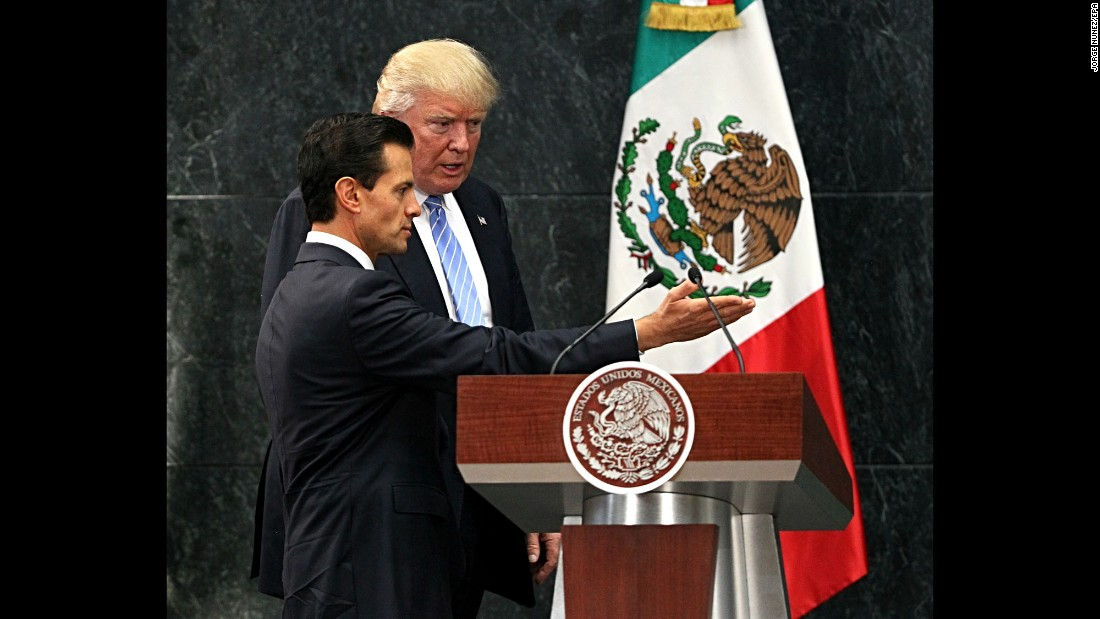 """Mexican President Enrique Peña Nieto, left, welcomes U.S. presidential candidate Donald Trump during a meeting in Mexico City on Wednesday, August 31. They discussed the wall that Trump vowed to build on the U.S.-Mexico border, but Trump said they didn't talk about his demand that Mexico pay for it -- <a href=""""http://www.cnn.com/2016/08/30/politics/donald-trump-enrique-pea-nieto-mexico/index.html"""" target=""""_blank"""">an assertion the Mexican President later disputed.</a>"""