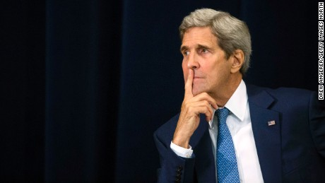 """U.S. Secretary of State John Kerry listens to the proceedings during an event releasing the """"2015 Trafficking in Persons Report,"""" at the U.S. State Department in 2015 in Washington, DC."""
