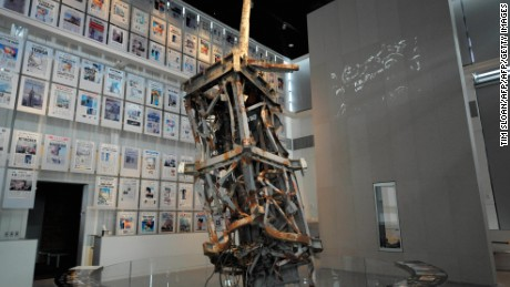 """TO GO WITH AFP STORY: US-MEDIA-CULTURE-MUSEUM BY Chris LEFKOW The mangled tv antenna from the World Trade Center anchors the 9/11 exhibit with a wall of that days front pages from around the world at the new Newseum building on April 1, 2008 in Washington, DC.  A shrine to journalism which traces the history of the news, the new attraction was built at a cost of 450 million USD and bills itself as the """"World's Most Interactive Museum"""" and opens its doors to the public this week.   AFP PHOTO / TIM SLOAN (Photo credit should read TIM SLOAN/AFP/Getty Images)"""