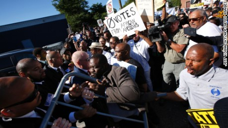 Protesters try to enter the property of Great Faith Ministries Church in Detroit before a visit by US Republican Presidential candidate Donald Trump on September 3 in Detroit, Michigan.