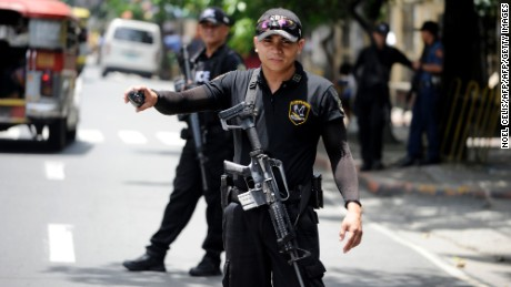SWAT team members patrol the streets of Manila in the wake of the Davao City bombing.