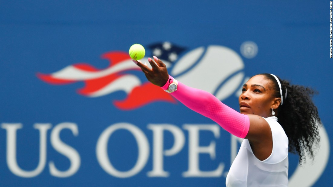 Serena Williams serves to Johanna Larsson during the pair's 2016 US Open round three match.