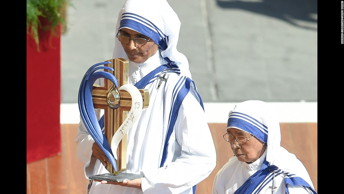 Nuns of the Missionary of Charity, the religious order founded by Mother Teresa, carry her relics during Mass.