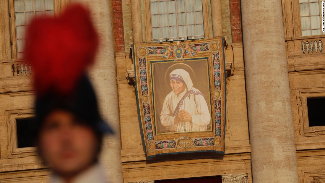 A tapestry showing Mother Teresa hangs from the facade of St. Peter's Basilica.