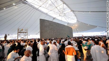 """Pilgrims throw pebbles at pillars during the """"Jamarat"""" ritual"""