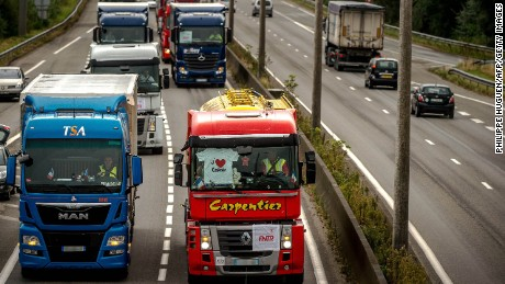 Truck drivers drive from Loon Plage to Calais.