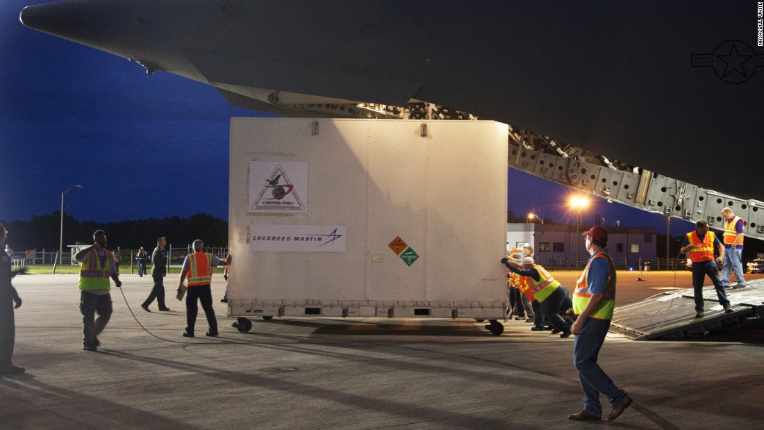 The OSIRIS-REx arrives at Kennedy Space Center on an Air Force C-17 aircraft. The spacecraft was shipped in this huge container from Lockheed Martin's facility near Denver. The spacecraft arrived at Kennedy on May 20.