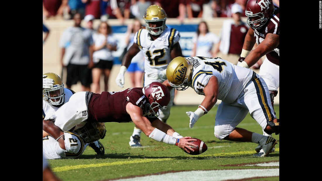 Texas A&M's Trevor Knight goes in for a one-yard touchdown during a game against UCLA in College Station, Texas, on Saturday, September 3. UCLA lost 24-31, and Texas A&M's win was one of five upsets in the first week of the college football season.