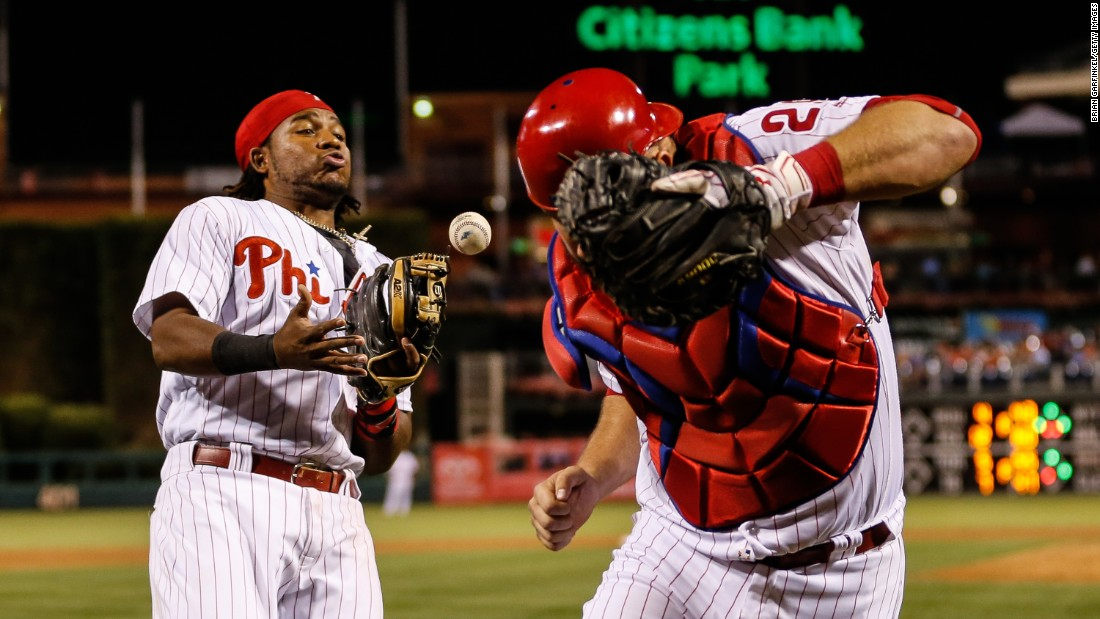 Philadelphia's Maikel Franco, left, attempts to catch a foul ball during a game against Atlanta in Philadelphia on Saturday, September 3. Atlanta won 6-4.