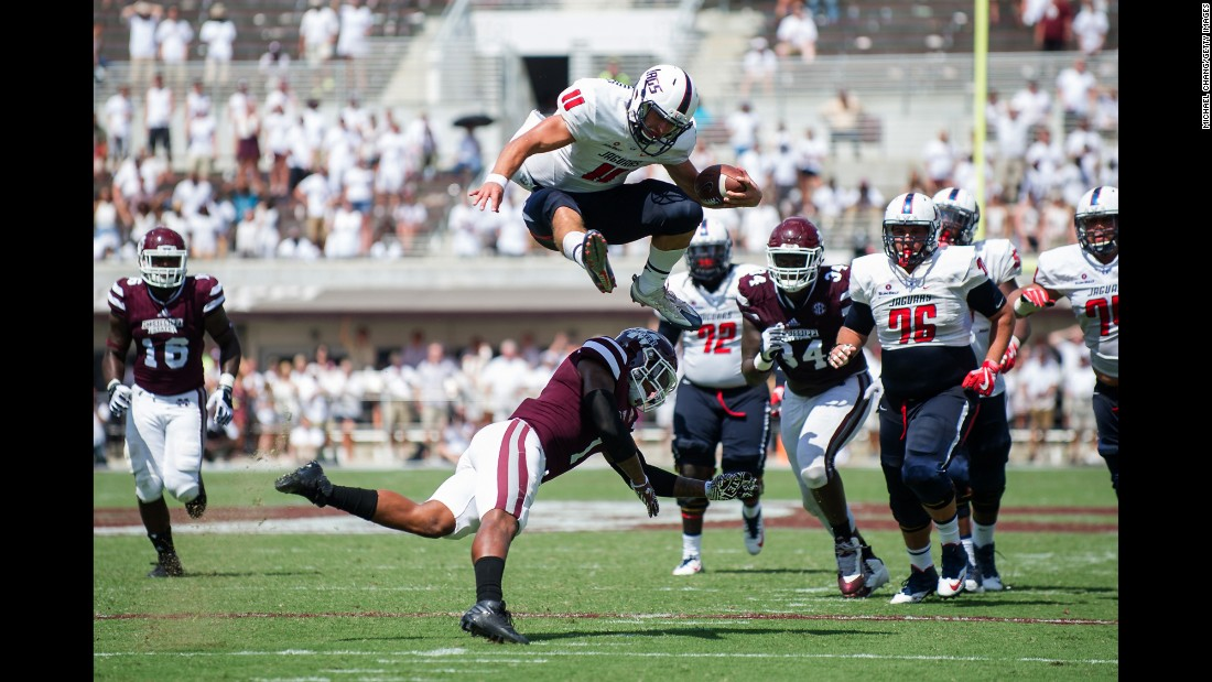 Dallas Davis of South Alabama leaps over Mississippi State's Brandon Bryant during a game in Starkville, Mississippi, on Saturday, September 3. Mississippi State lost by just one point, 20-21.