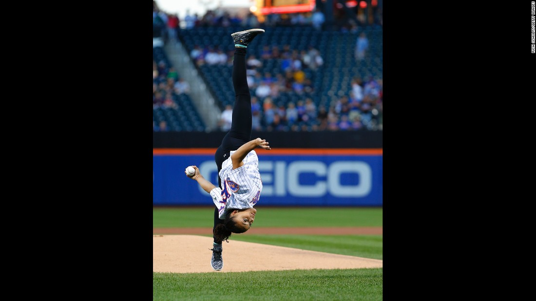 Olympic gold-medal gymnast Laurie Hernandez flips as she throws the first pitch in a game between the Washington Nationals and New York Mets in New York on Saturday, September 3. The Mets won 3-1.