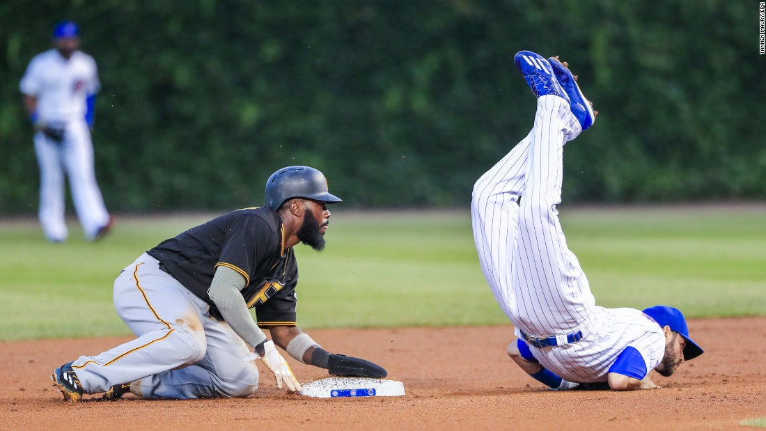 Pittsburgh's Josh Harrison, left, looks on as Tommy La Stella of Chicago falls during a game in Chicago on Wednesday, August 31. Chicago won 6-5.