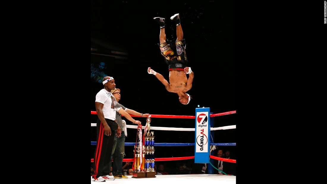 Panama's Luis Concepcion celebrates after defeating Japan's Kohei Kono in a WBA world super-flyweight bout in Tokyo on Wednesday, August 31.