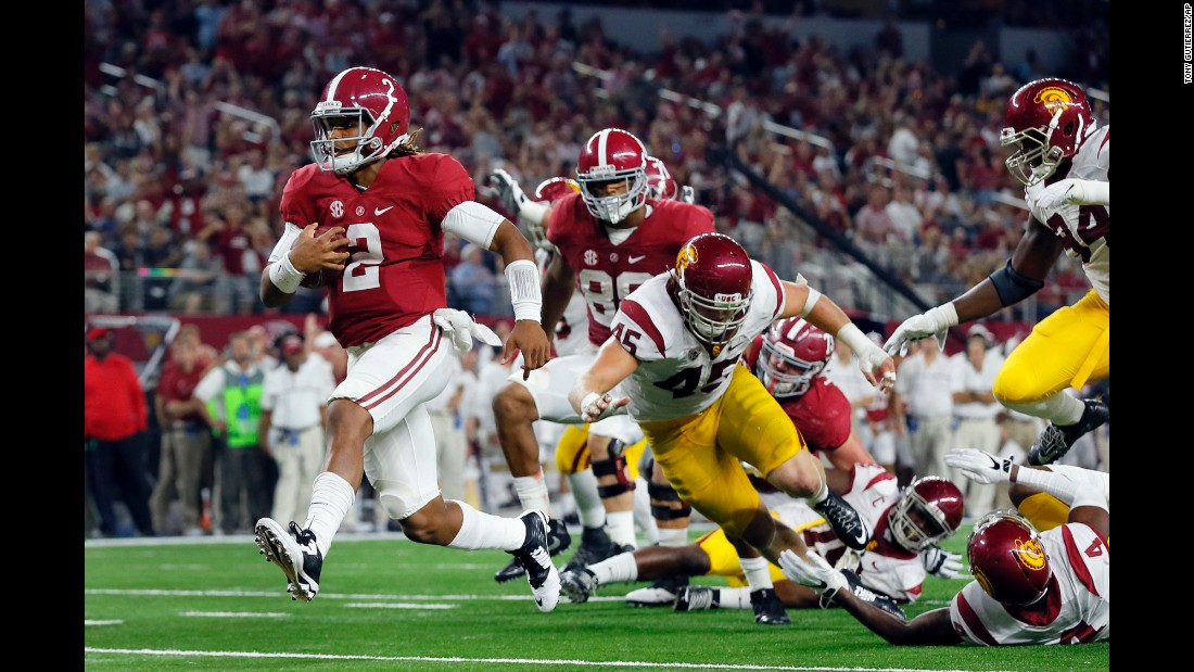 Alabama's Jalen Hurts runs for a seven-yard touchdown during a game against University of Southern California in Arlington, Texas, on Saturday, September 3. Alabama won by a landslide, defeating USC 52-6.